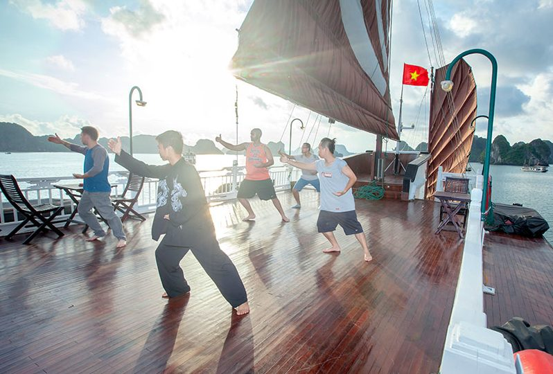 bhaya classic cruises tai chi on sundeck 2 0 e1543552294890 - Top 10+ Unique & Amazing Things to do in Halong Bay, Vietnam (2020)